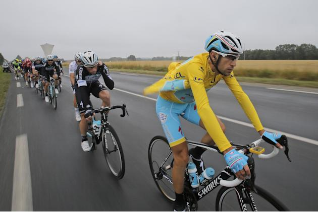 Italy's Vincenzo Nibali, wearing the overall leader's yellow jersey, rides in the pack during the seventh stage of the Tour de France cycling race over 234.5 kilometers (145.7 miles) with star