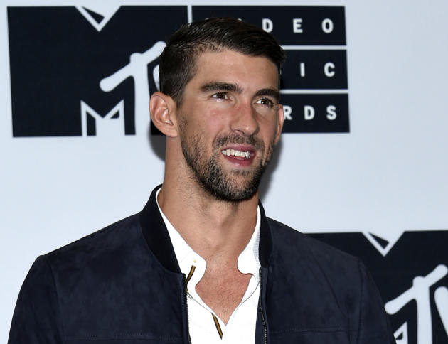 """FILE - In this Aug. 28, 2016 file photo, Michael Phelps poses in the press room at the MTV Video Music Awards in New York. Phelps will be named Sports Illustrated's """"Person of the Year"""""""