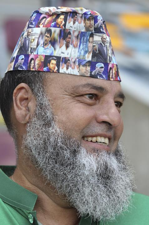 A Pakistani fan sports a cap with pictures of Indian captain M.S.Dhoni during the Pool B Cricket World Cup match between Pakistan and Zimbabwe in Brisbane, Australia, Sunday, March 1, 2015. (AP Photo/