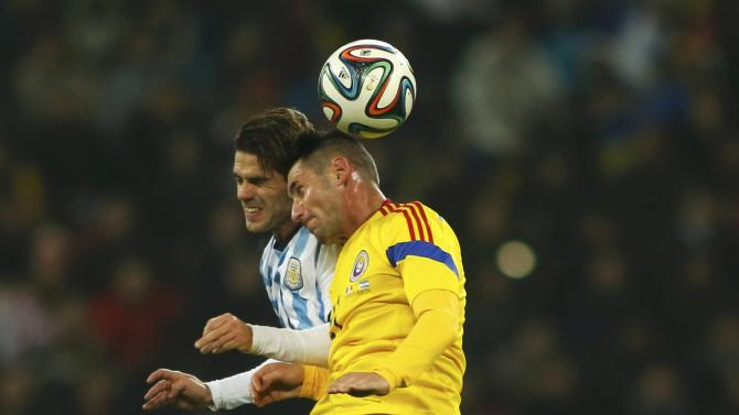 Argentina's Gago challenges Romania's Grigore during their international friendly soccer match at the National Arena in Bucharest