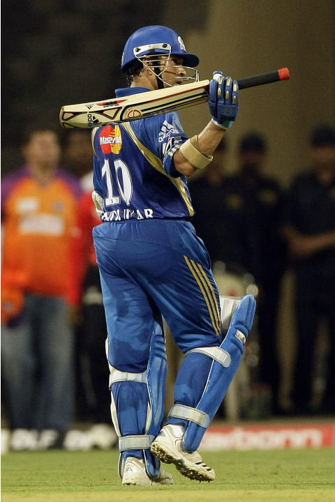 Mumbai Indians' Sachin Tendulkar , after scoring a century during the Indian Premier League (IPL) cricket match against Kochi Tuskers Kerala in Mumbai, India, Friday, April 15, 2011. (AP Photo/Raj