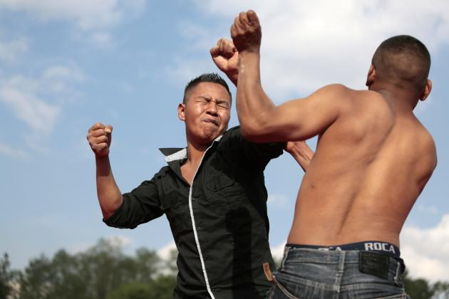 Two men participate in a bare-knuckle fight at a boxing ring in the village of Chivarreto