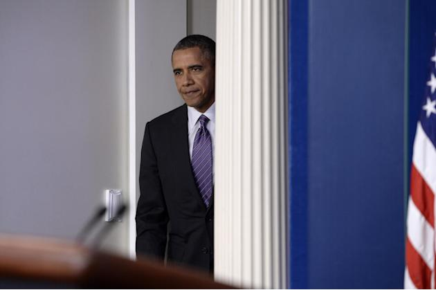 President Barack Obama arrives in the briefing room of the White House in Washington, Thursday, April 17, 2014, where he spoke about health care overhaul and the situation in Ukraine. (AP Photo/Susan