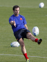 French rugby player Morgan Parra kicks the ball during a training session, in Auckland, New Zealand, Tuesday, Sept. 27, 2011. France will play Tonga in their next Rugby World Cup match on Saturday, Oct. 1 in Wellington. (AP Photo/Christophe Ena)