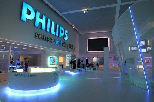 Electronics giant Philips on Tuesday reported 2012 net profits of 231 million euros (311 million dollars), after losses of 1.29 billion euros in 2011, and announced the sale of its entertainment business to focus further on health products