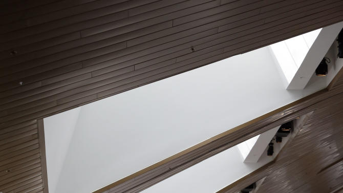 This April 12, 2013, photo shows the curving roofline over a lobby in the Music City Center in Nashville, Tenn. Nashville's new convention center is transforming the look of downtown with its wavy roof dominating six city blocks, but tourism officials hope the eye-catching facility will also show business travelers a revitalized Music City. (A P Photo/Mark Humphrey)