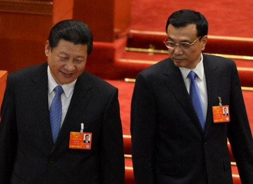 Newly-elected Chinese President Xi Jinping (left) and Premier Li Keqiang arrive to vote during the election of the new vice premiers, foreign and defense ministers during the 12th National People's Congress (NPC) at the Great Hall of the People in Beijing, on March 16, 2013.