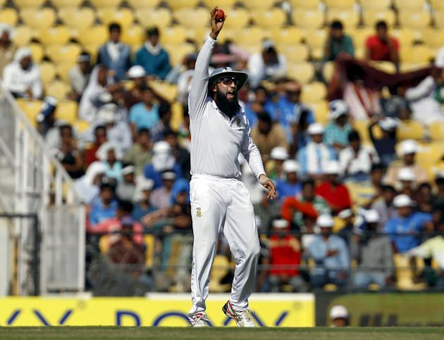 South Africa's captain Amla appeals unsuccessfully for a catch to dismiss India's Saha during the second day of their third test cricket match in Nagpur