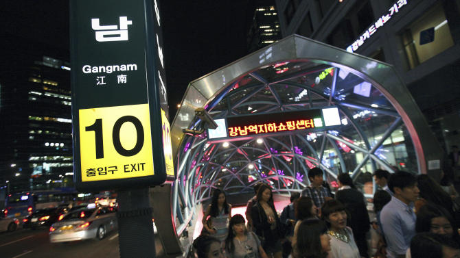 "In this Friday, Sept. 14, 2012 photo, people stream into a street near Gangnam Station in Seoul, South Korea. About 1 percent of Seoul's population lives in the district of Gangnam, but many of its residents are very rich. Today, South Korean rapper PSY's ""Gangnam Style"" video has more than 200 million YouTube views and counting, and it's easy to see why. Gangnam is only a small slice of Seoul, but it inspires a complicated mixture of desire, envy and bitterness. It's also the spark for PSY's catchy, world-conquering song. (AP Photo/Hye Soo Nah)"