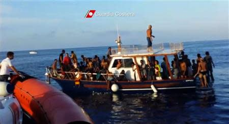 A still image taken from video released on October 4, 2013 by the Italian Coastguard shows migrants rescued from the water off the southern Italian island of Lampedusa on Thursday October 3, 2013. REUTERS/Italian Coast Guard/Handout via Reuters