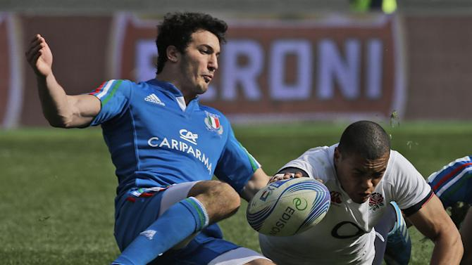 England's Luther Burrell, right, eyes the ball as Italy's Leonardo Sarto tries to stop him during a Six Nations international rugby union match between Italy and England, in Rome, Saturday, March 15, 2014. Owen Farrell accounted for 22 points and Mike Brown added two tries as England stated its case for the Six Nations title with a convincing 52-11 win over Italy on Saturday at the Stadio Olimpico