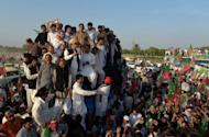Leaders of Pakistan's Movement for Justice party watch Imran Khan (centre) as he addresses supporters in Tank on October 7. Khan claimed victory Sunday at the end of his march against US drone strikes, despite failing to reach his intended destination in Pakistan's tribal areas.
