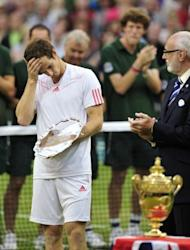Andy Murray, seen here with runner's-up trophy after his men's singles final defeat to Switzerland's Roger Federer on Day 13 of the 2012 Wimbledon Championships at the All England Tennis Club in southwest London, on July 8. Federer won the title 4-6, 7-5, 6-3, 6-4