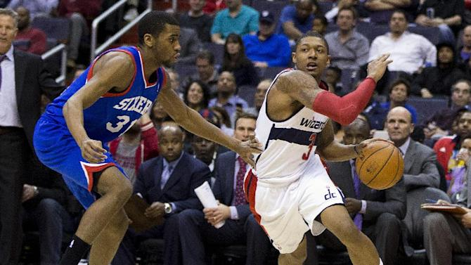 Washington Wizards shooting guard Bradley Beal, right, drives to the basket against Philadelphia 76ers shooting guard Hollis Thompson during the second half of an NBA basketball game on Monday, Jan. 20, 2014 in Washington. The Wizards defeated the 76ers 107-99
