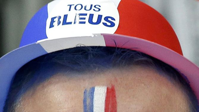 A French fan attends the international friendly soccer match between France and the Netherlands at the Stade de France in Saint-Denis