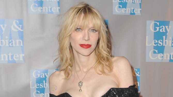 """FILE - In this May 19, 2012 file photo, musician Courtney Love attends """"An Evening With Women,"""" in Los Angeles. Love's former assistant sued the Hole front-woman on Tuesday, July 10, 2012 in Los Angeles, claiming the rocker owes her unpaid wages and asked her to perform unethical duties such as hiring a hacker and forge legal correspondence.  (Photo by Jordan Strauss/Invision, File)"""