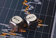 Dices cubes to trader. Cubes with the words SELL BUY. Selective