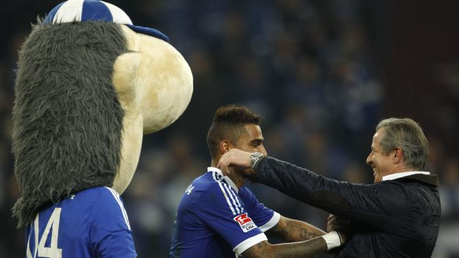 Schalke 04's Boateng and his coach Keller celebrate victory against Werder Bremen during the German first division Bundesliga soccer match in Gelsenkirchen