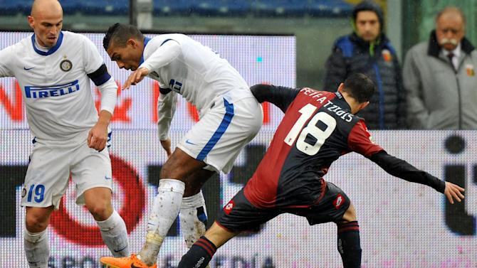 Inter Milan's Juan Jesus of Brazil, left, vies for the ball with Genoa's Giannis Fetfatzidis of Greece, during a Serie A soccer match at Genoa's Luigi Ferraris Stadium, Italy, Sunday, Jan. 19 2014