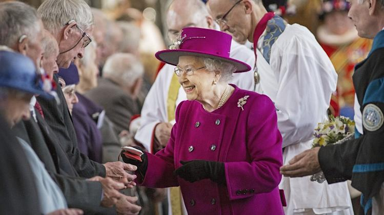 The Queen hands out Maundy money at Blackburn Cathedral in Lancashire