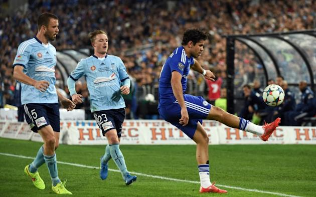 Chelsea forward Diego Costa (R) is challenged by Sydney FC defenders Rhyan Grant (2L) and Matthew Jurman (L) during a friendly in Sydney on June 2, 2015