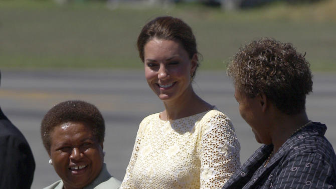 Britain's Kate, the Duchess of Cambridge, center, chats with Lady Kabui, left, the wife of the Solomon Islands' Governor General, and Madam Lilo, wife of the Solomon Islands' prime minister, as Kate and  Prince William prepare to depart in Honiara, Solomon Islands, Tuesday, Sept. 18, 2012, after an official visit to the South Pacific Island Nation.  (AP Photo/Rick Rycroft)