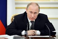 Russia's Prime Minister and president-elect Vladimir Putin chairs a cabinet meeting in Moscow on March 29. Putin suffered a tough political blow Monday after seeing his party's candidate trounced in a mayoral race that became the focus of Russia's nascent protest movement