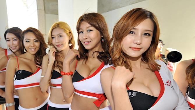 South Korean grid girls pose in the paddock as they prepare ahead of the start of the Formula One Korean Grand Prix in Yeongam on October 16, 2011. AFP PHOTO/JUNG YEON-JE (Photo credit should read JUNG YEON-JE/AFP/Getty Images)