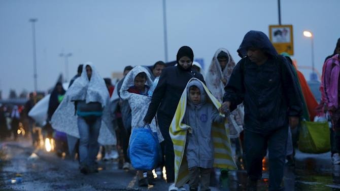 Migrants arrive at the Austrian-Hungarian border station of Hegyeshalom, Hungary