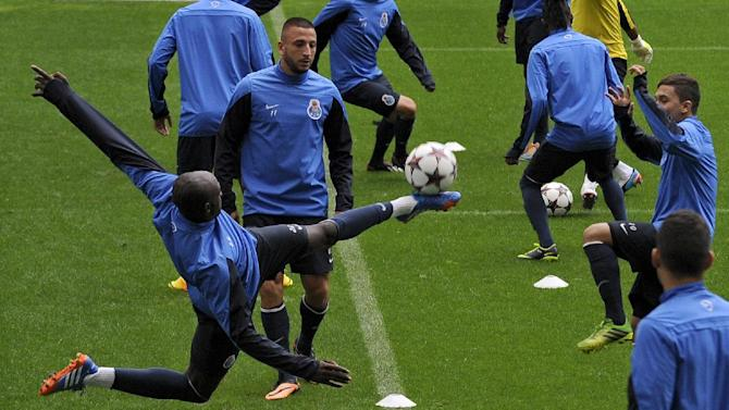 FC Porto's Eliaquim Mangala, left, from France kicks the ball toward Juan Quintero, right, from Colombia and Nabil Ghilas, center, from Algeria, during a training session at the Dragao stadium, in Porto, Portugal, Monday, Sept. 30, 2013. Porto will play Atletico Madrid in a Champions League group G soccer match on Tuesday, Oct. 1