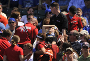 A fan is carried away after being hit by a line-drive foul ball at Wrigley Field. (AP)