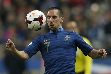 France's Franck Ribery controls the ball during the 2014 World Cup qualifying soccer match against Finland at the Stade de France stadium in Saint-Denis, near Paris
