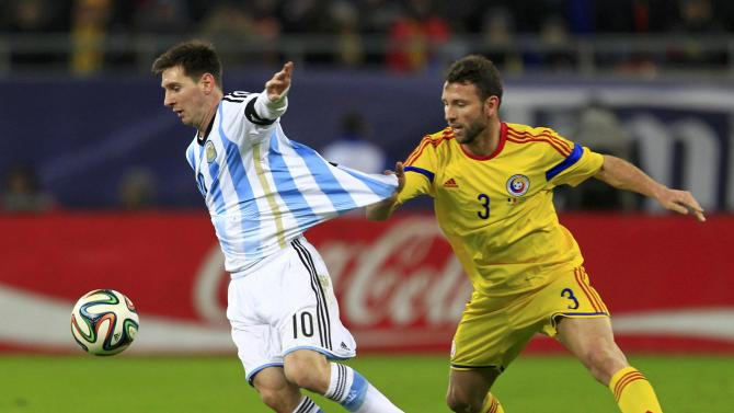 Argentina's Messi challenges Romania's Rat Dinca during their international friendly soccer match at the National Arena in Bucharest