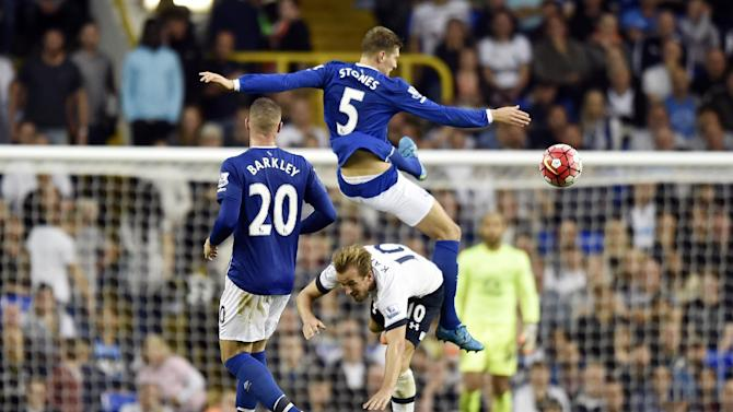 Everton's John Stones in action with Tottenham's Harry Kane