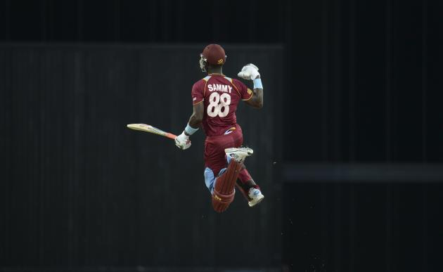 West Indies' Sammy leaps to celebrate after the West Indies won their second T20 international cricket match against England in Barbados