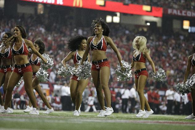 Atlanta Falcons cheerleaders perform during the second half of an NFL football game against the New Orleans Saints, Sunday, Sept. 7, 2014, in Atlanta. (AP Photo/David Goldman)
