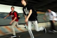 Teenagers skateboard along a shady underpass in New York City. Thirty-three percent of teens surveyed favored texting, while only 7% preferred a social networking site -- and in a sign of how times have changed, a mere 4% favored talking over the telephone