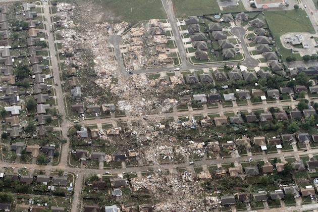 Aerial photo shows the remains of homes hit by a massive tornado in Moore, Okla.