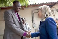 US Secretary of State Hillary Clinton (R) meets with Bishop Elias Taban in Juba, South Sudan. Clinton Friday paid tribute to a Ugandan human rights coalition working for gay rights, hours after a brief stop in Juba where she called for a compromise deal between the rival two Sudans