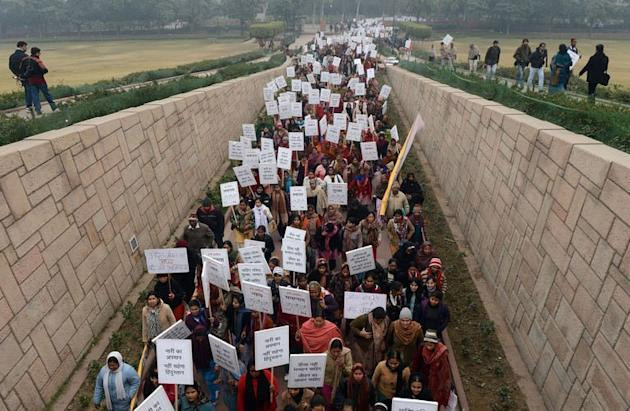 Indian women hold placards during a march in New Delhi to show solidarity after a deadly gang rape on January 2, 2013. A gang of men accused of repeatedly raping a 23-year-old student on a moving bus in New Delhi in a deadly crime that repulsed the nation are to appear in court on Thursday for the first time