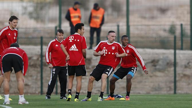 Bayern's Daniel van Buyten, from left, Thiago Alcantara of Spain, Franck Ribery of France and David Alaba of Austria watch the ball at the Club World Cup soccer tournament in Agadir, Morocco, Sunday, Dec. 15, 2013. Bayern Munich will face Guangzhou Evergrande in the first semi final on Tuesday, Dec 17