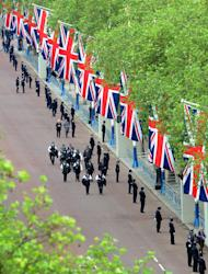 Police arrive in the Mall, London, before Queen Elizabeth II leaves Buckingham Palace, London, for a service of thanksgiving at St Paul's Cathedral as part of the Diamond Jubilee celebrations Tuesday June 5, 2012. Queen Elizabeth II will make a rare address to the nation at the conclusion of festivities marking her 60 years on the throne. (AP Photo/Anthony Devlin, Pool)