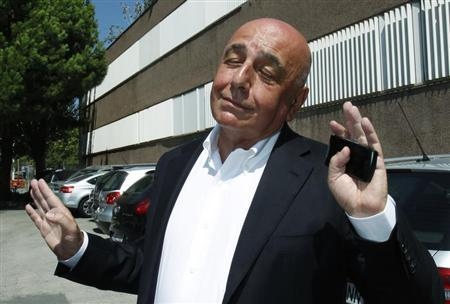 AC Milan's chief executive officer Adriano Galliani gestures as he leaves FC Barcelona's office in Barcelona