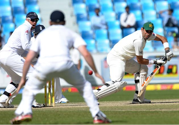 Pakistan's captain Misbah-ul Haq (R) plays a shot as wicketkeeper Matt Prior (L) looks on during the third day of the third and final Test match between Pakistan and England at the Dubai International