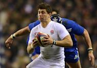England scrum-half Ben Youngs runs with the ball during the Six Nations international against France at Twickenham on February 23, 2013. In a match of brutal breakdown battles and fearsome collisions, France led 10-9 at half-time, before the hosts stormed back