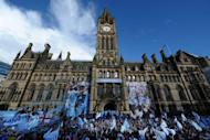 Manchester City players stand with their manager Roberto Mancini as they celebrate becoming English Premier League champions in a parade leaving from Manchester Town Hall