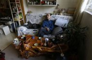 51 year-old Tian Lianpu, father of the late Tian Yao, born in August 1990 and died in January 2012 of lymphoma, pauses as he drinks tea at home in Beijing, December 26, 2013. REUTERS/Jason Lee