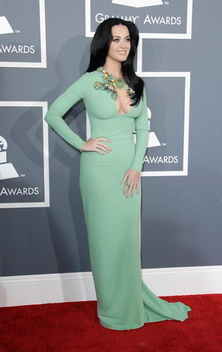 Grammys 2013: Best and Worst Dressed. Katy Perry got a whole load of boob out in this floor length green gown. Copyright: [getty]