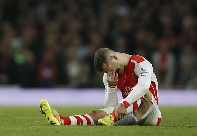 Arsenal's English midfielder Jack Wilshere lies injured during their English Premier League match against Manchester United, at the Emirates Stadium in London, on November 22, 2014