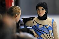 Emirati figure skater Zahra Lari (R) speaks with her coach Noemi Bedo prior performing at the European Cup, on April 12, in Canazei, northern Italy. 17-year-old Lari becomes the first Emirati figure skater to compete in an international competition with skaters from 50 countries taking part in the event